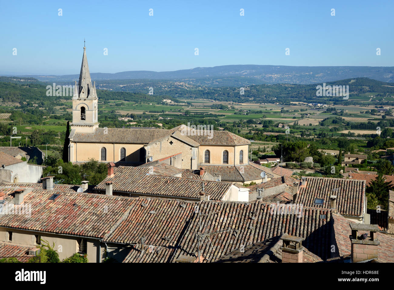 Panoramic View over the Village of Bonnieux, the New Church and the Main Plain of the Luberon Regional Park Provence - Stock Image