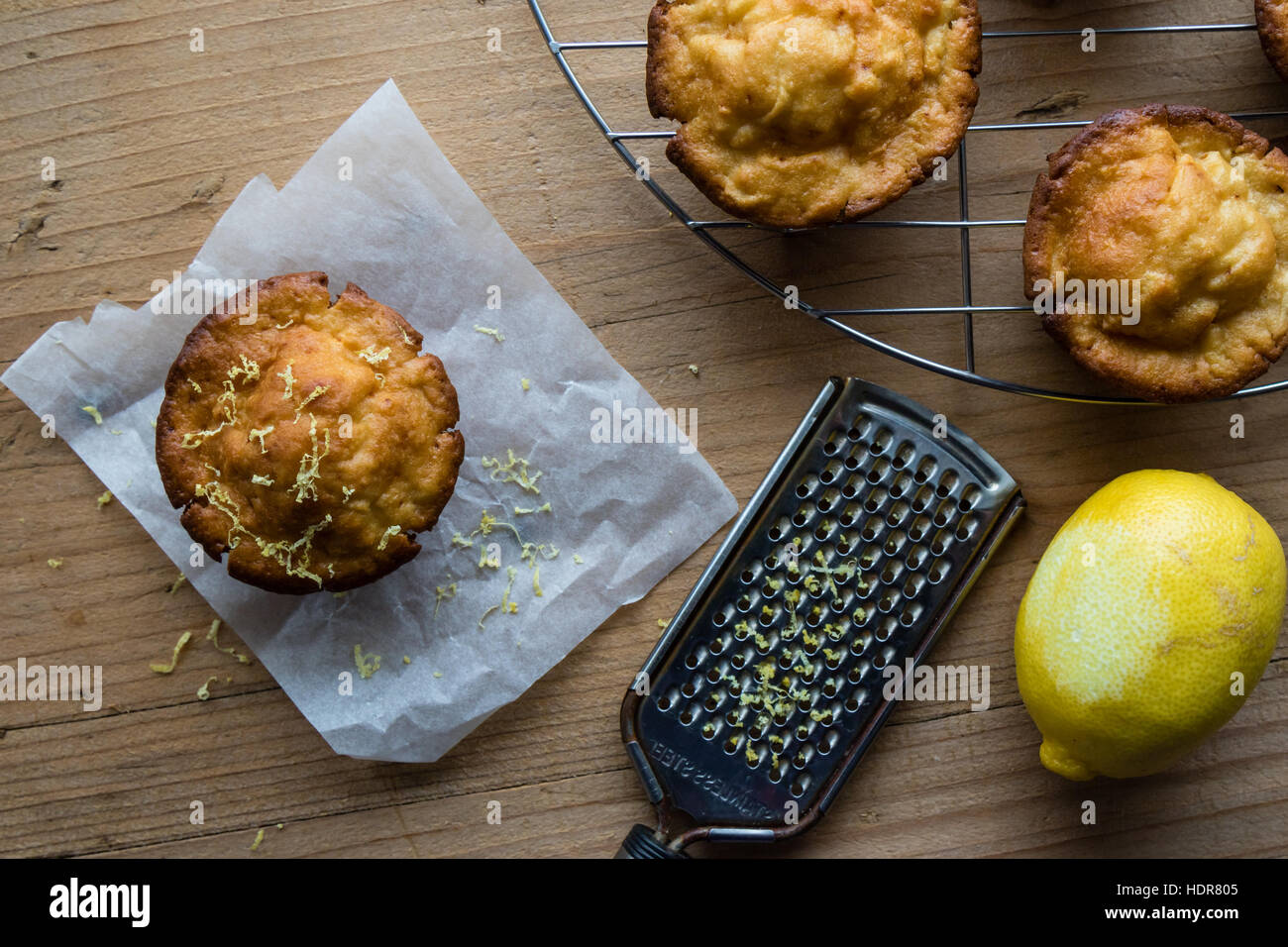 homemade fresh lemon muffin on wooden table - Stock Image