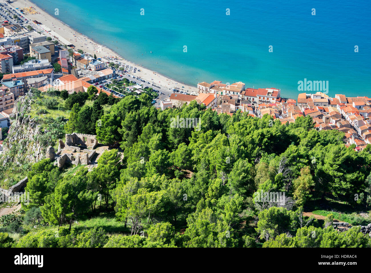 Town beach and cliff La Rocca view, Cefalu, Sicily, Italy, Europe - Stock Image