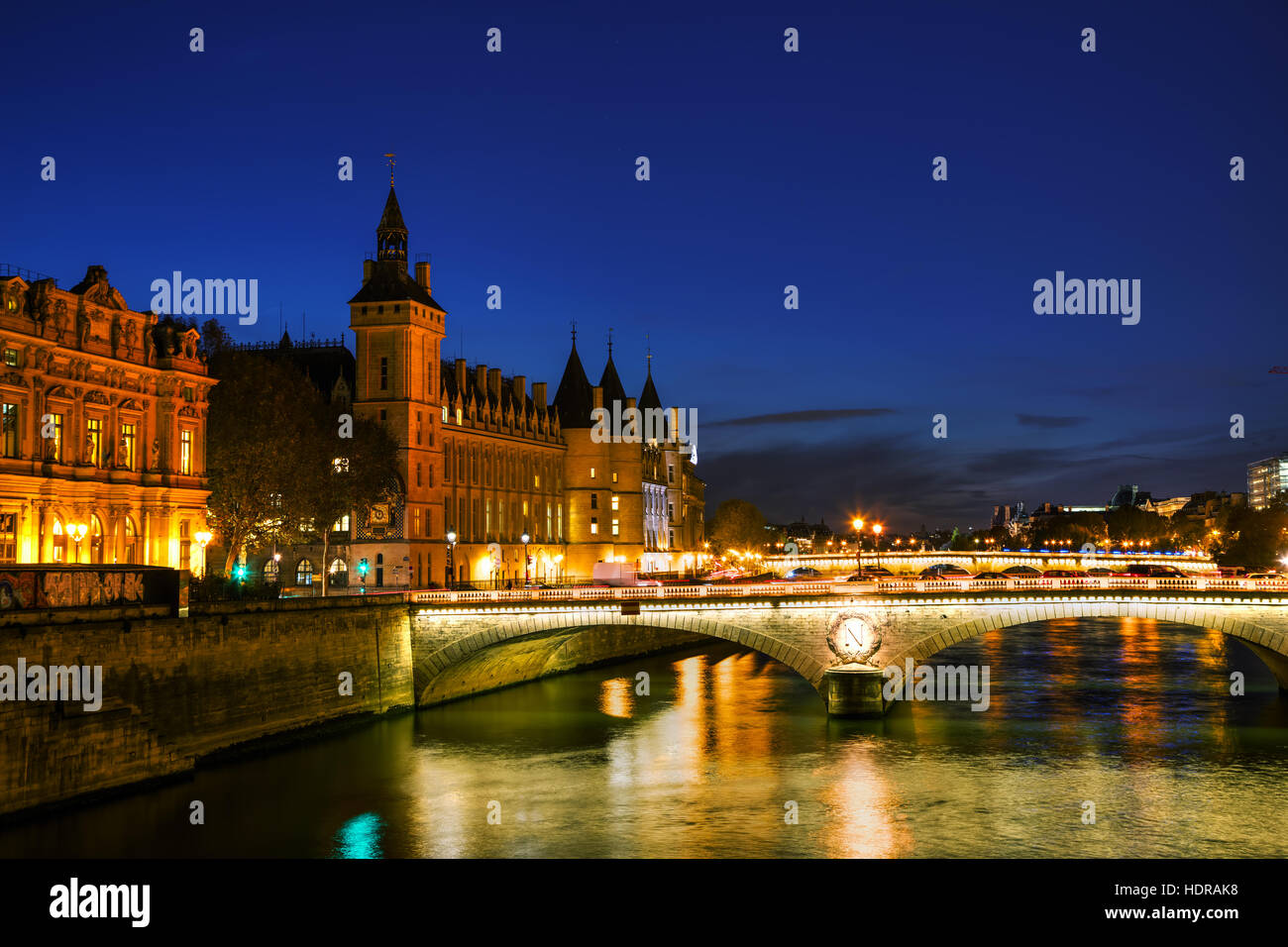 The Conciergerie building in Paris, France in the night Stock Photo