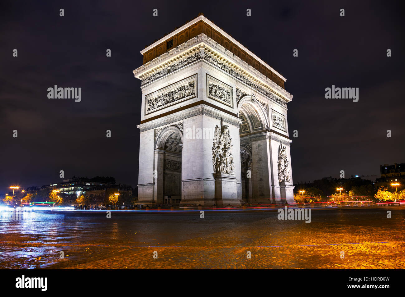 The Triumphal Arch (Arc de Triomphe) in Paris, France at night - Stock Image