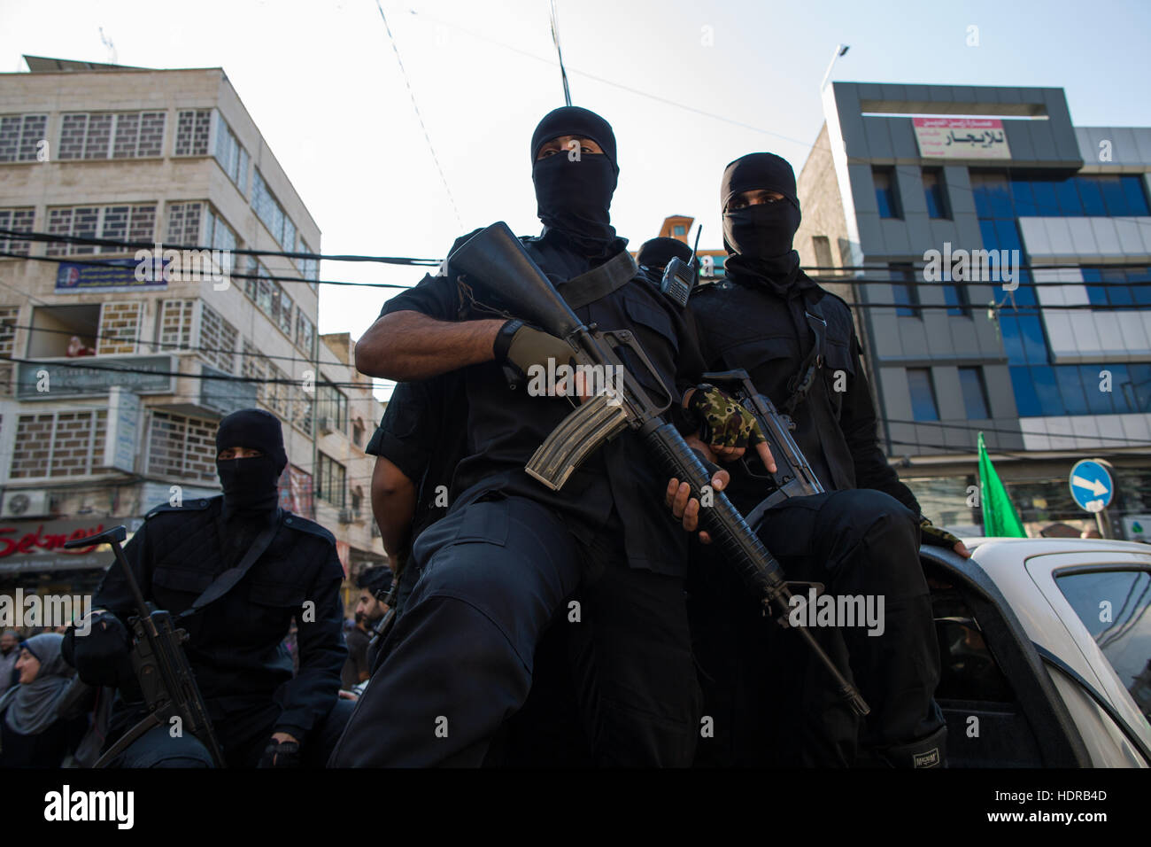 Fighters from the Al-Qassam brigade, the military wing of Hamas organisation, at a celebration of their 48th anniversary. Stock Photo