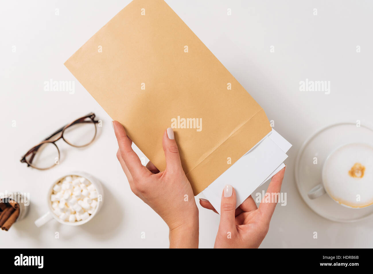 Nice pleasant woman sending letters - Stock Image