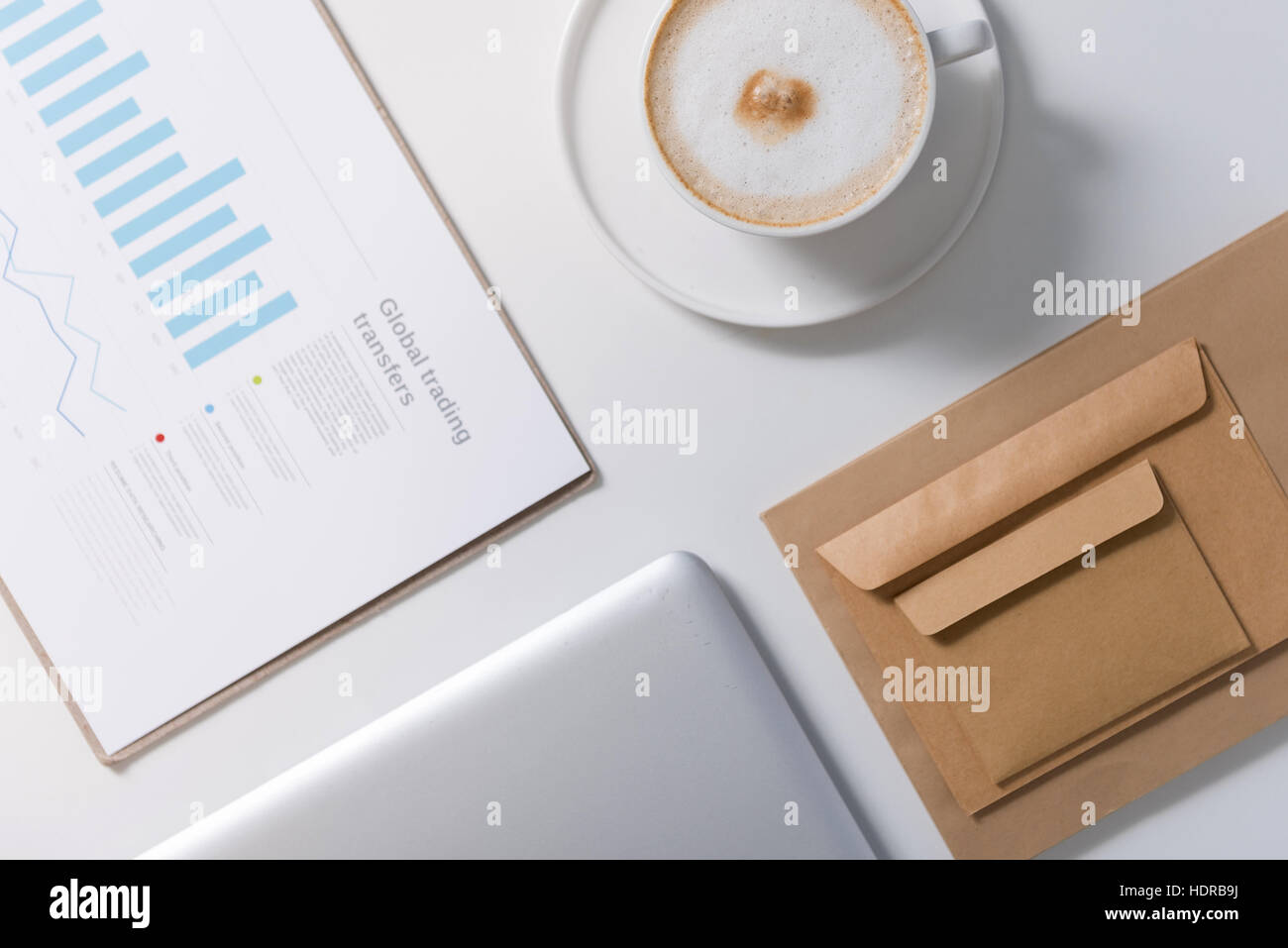 Statistical data documents lying on the table - Stock Image