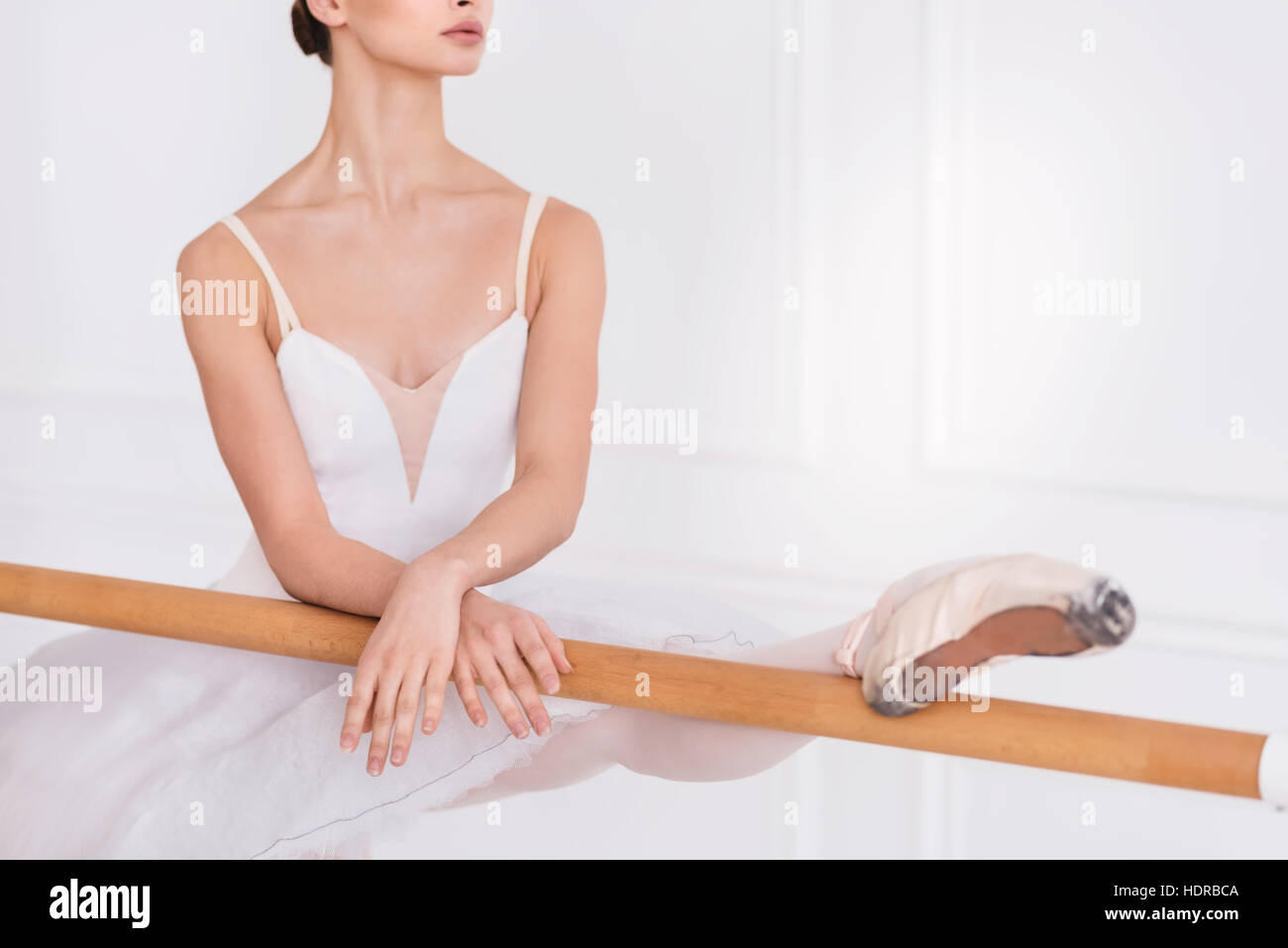 Close up of ballet dancer while stretching - Stock Image