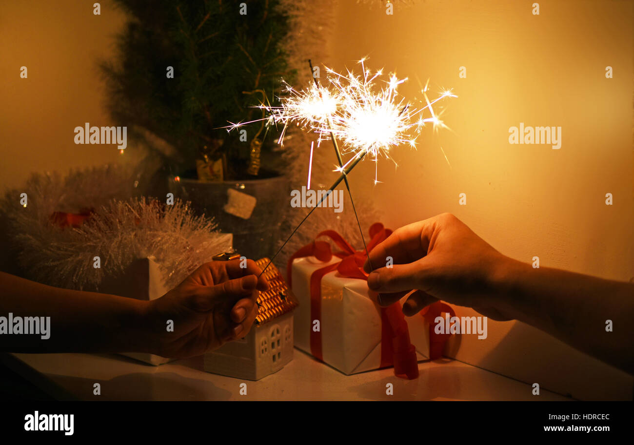 Christmas sparklers in darkness. Stock Photo