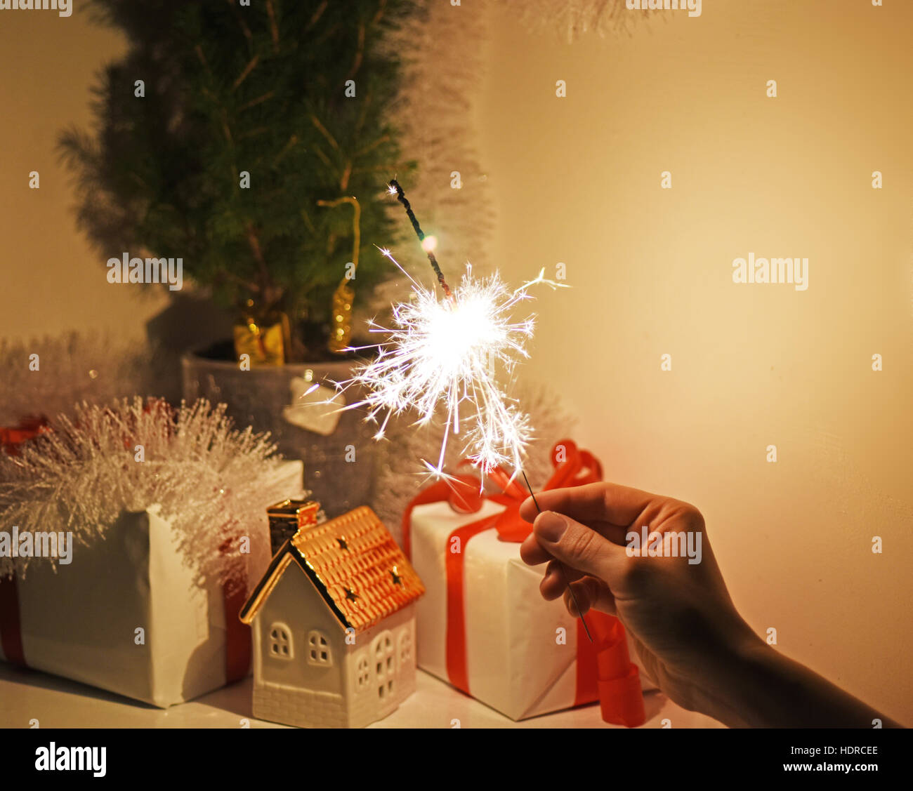 Christmas sparklers in darkness. - Stock Image
