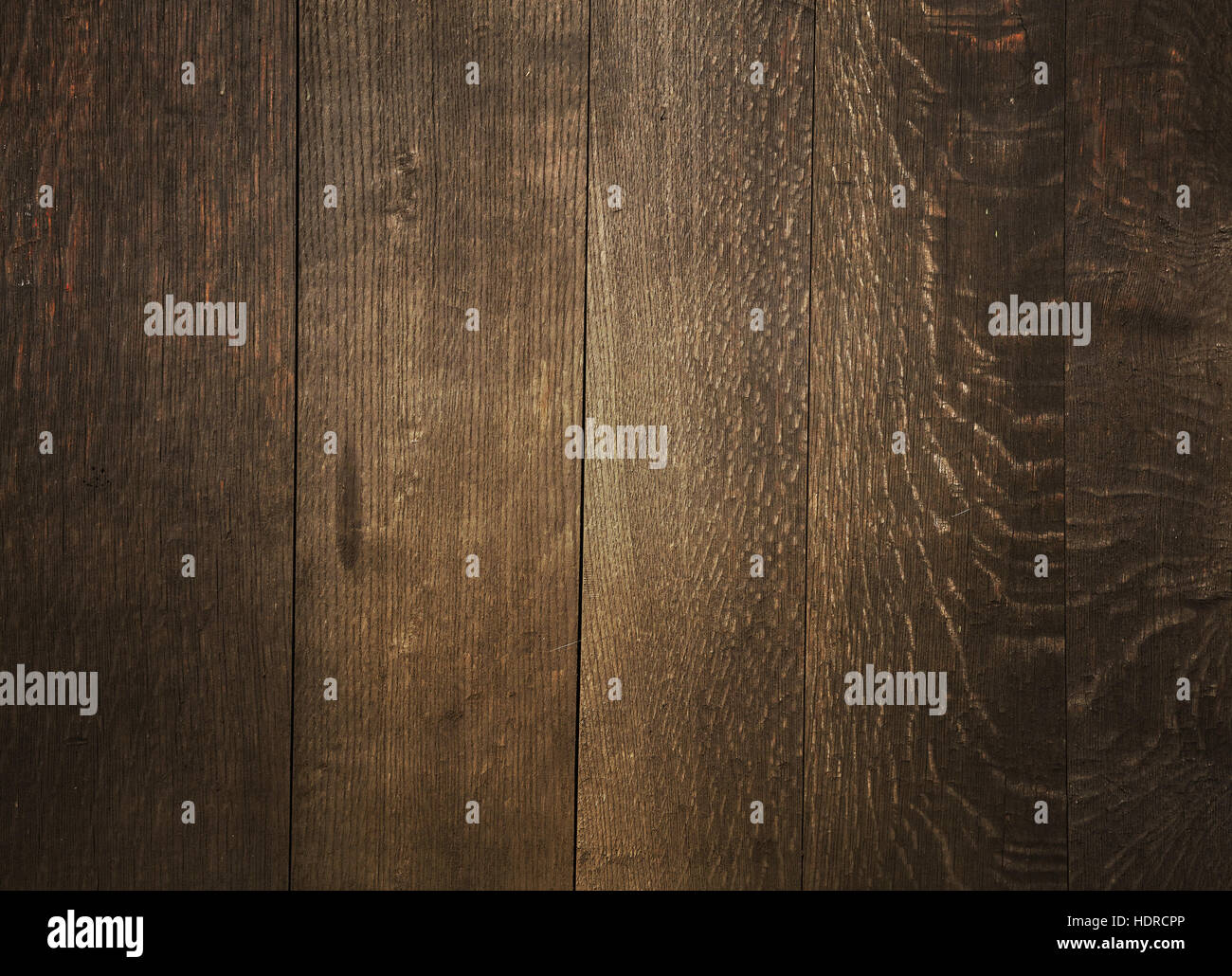 dark brown wood floor texture. Old vintage aged grunge dark brown wooden floor planks texture background  with light center and shaded border edges Stock