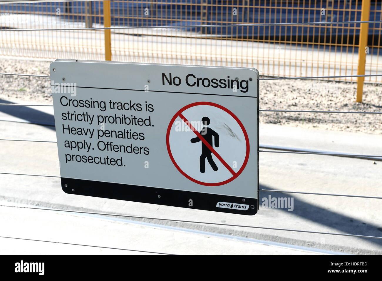 No crossing on tram tracks warning sign - Stock Image