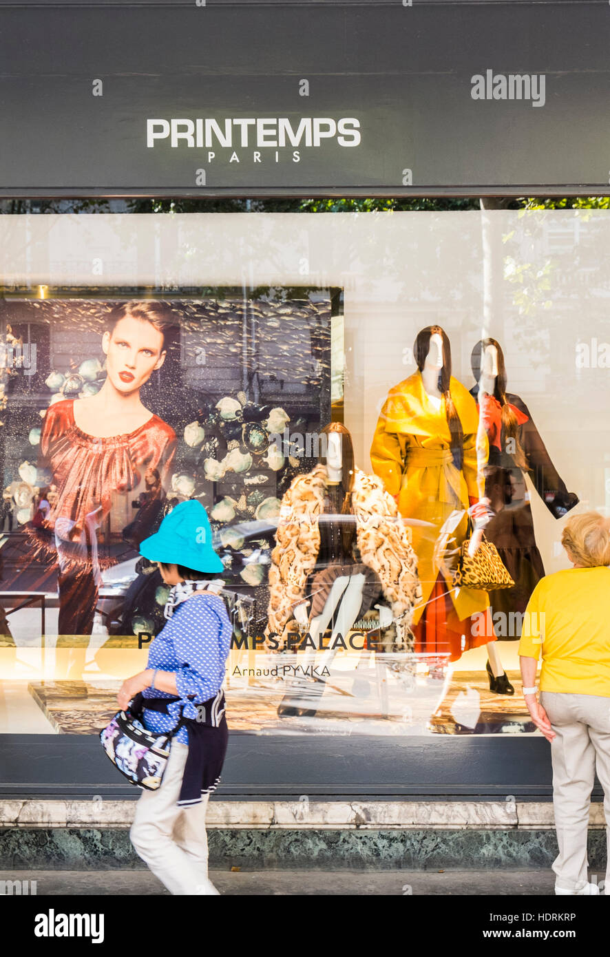 street scene in front of shop window of printemps department store - Stock Image