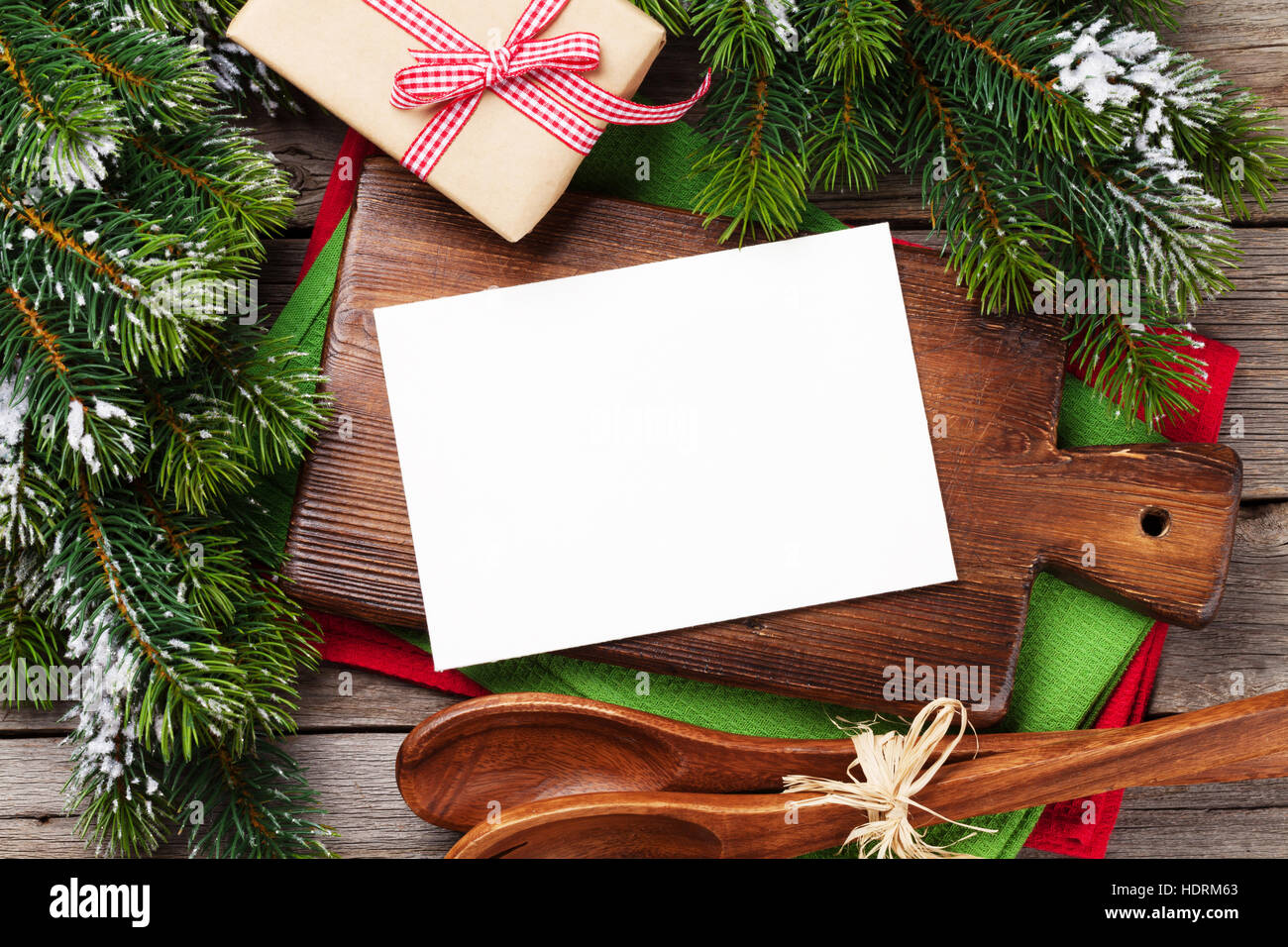 Christmas Greeting Card Over Cooking Table And Utensils Top View