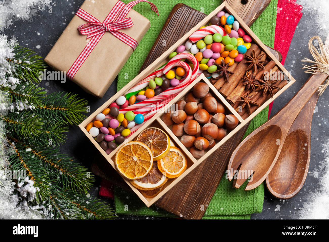 Christmas food decor and gift box. Xmas cooking table and fir tree ...