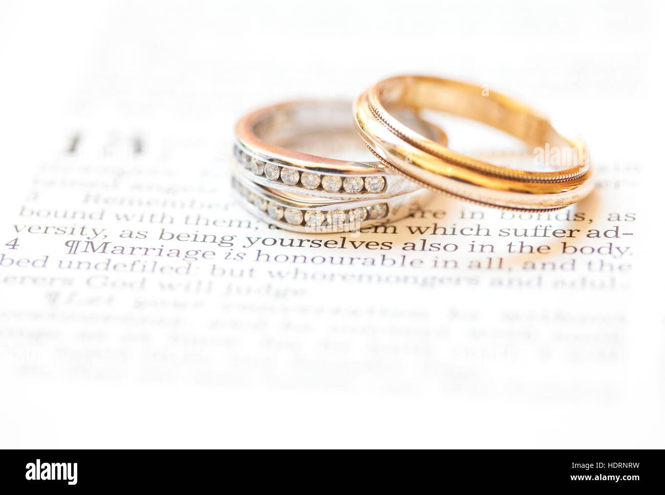 Wedding bands placed over the scripture Hebrews 13:4; Waco, Texas, United States of America - Stock Image