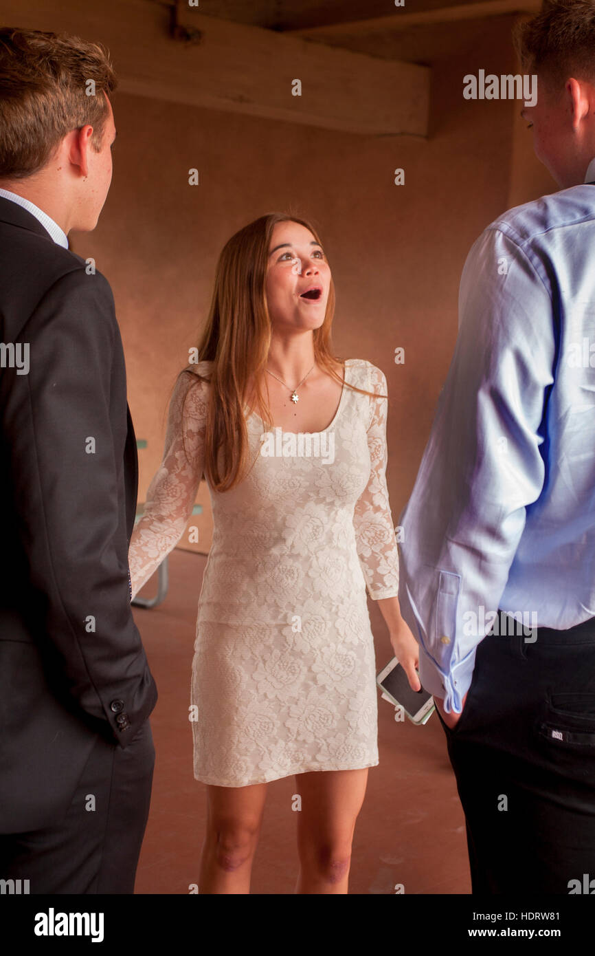 Wearing A White Formal Dress A Teenage Girl Socializes While