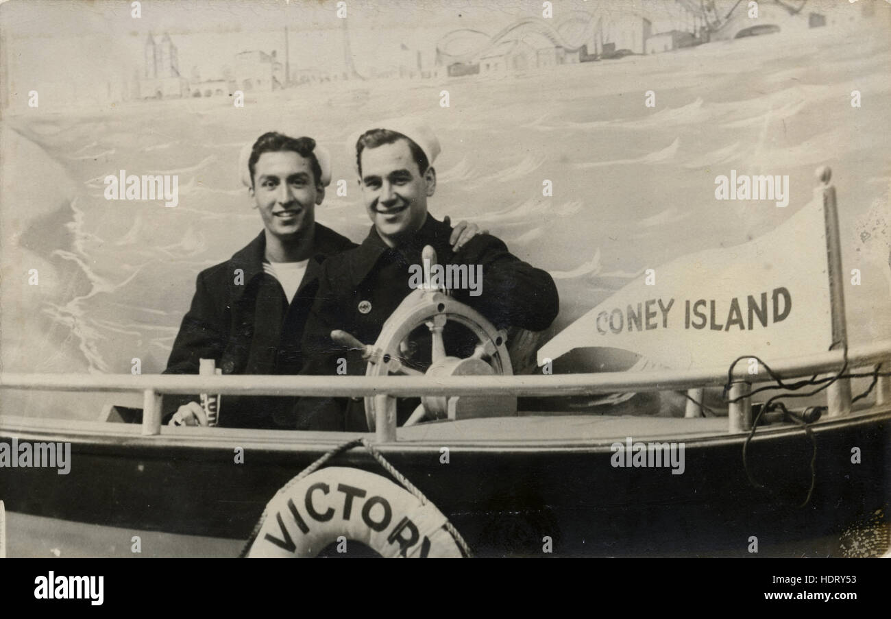 Antique c1910 photograph, two men in a souvenir photographic postcard from Coney Island, Brooklyn, New York City, - Stock Image