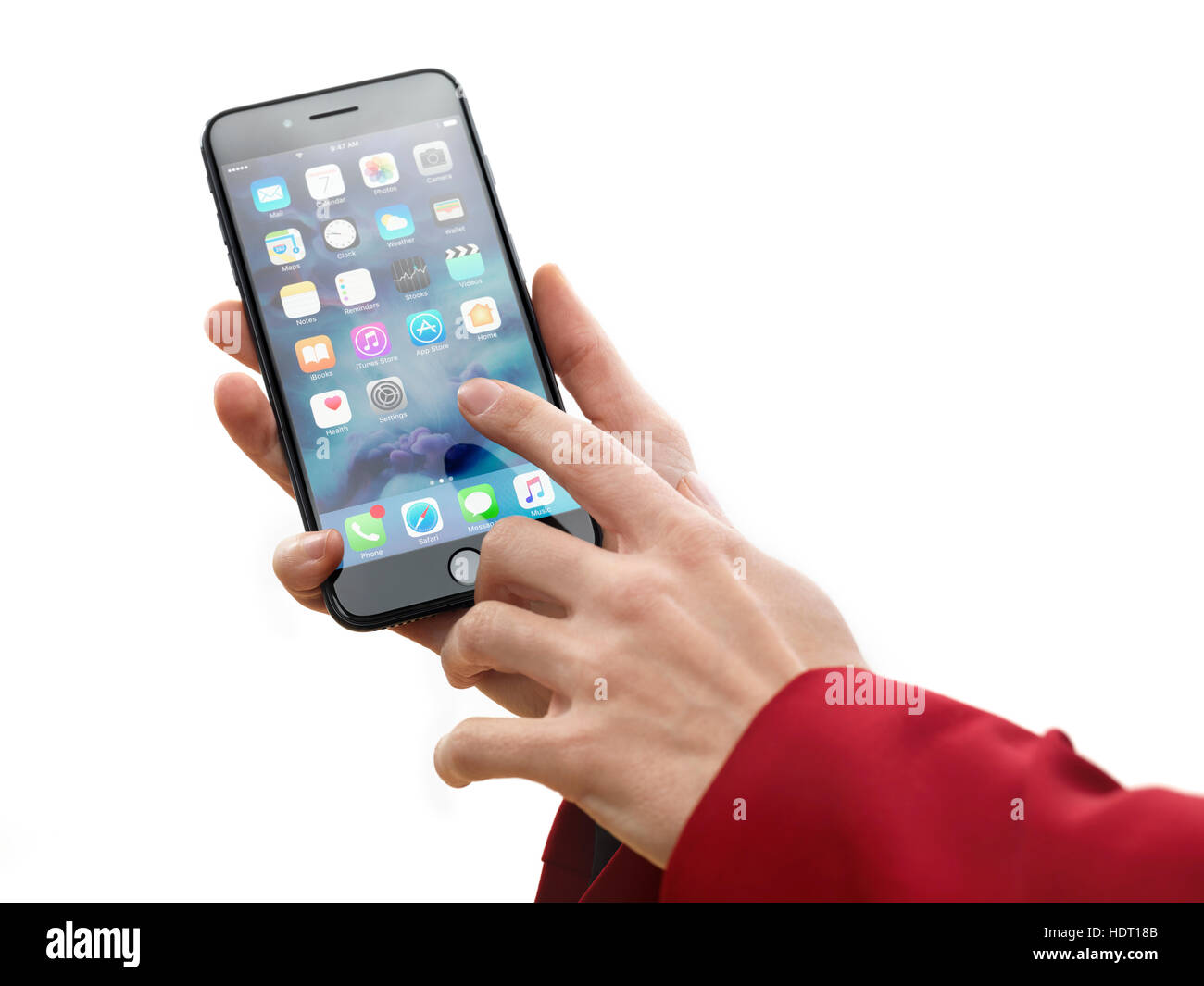 Woman hand holding Apple iPhone 7 Plus and touching screen with a finger isolated on white background - Stock Image