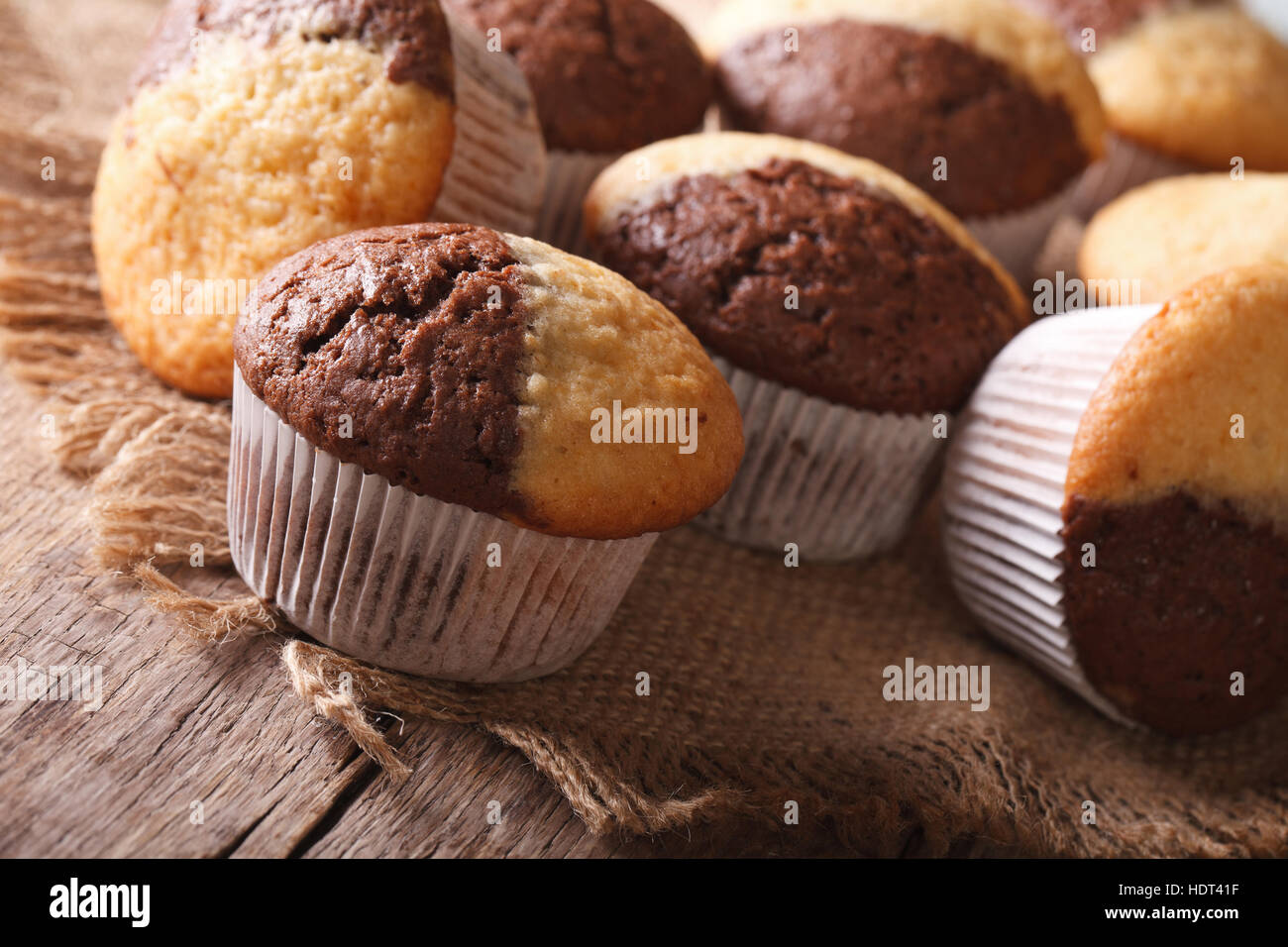 Delicious chocolate orange muffin on the table close-up, horizontal - Stock Image