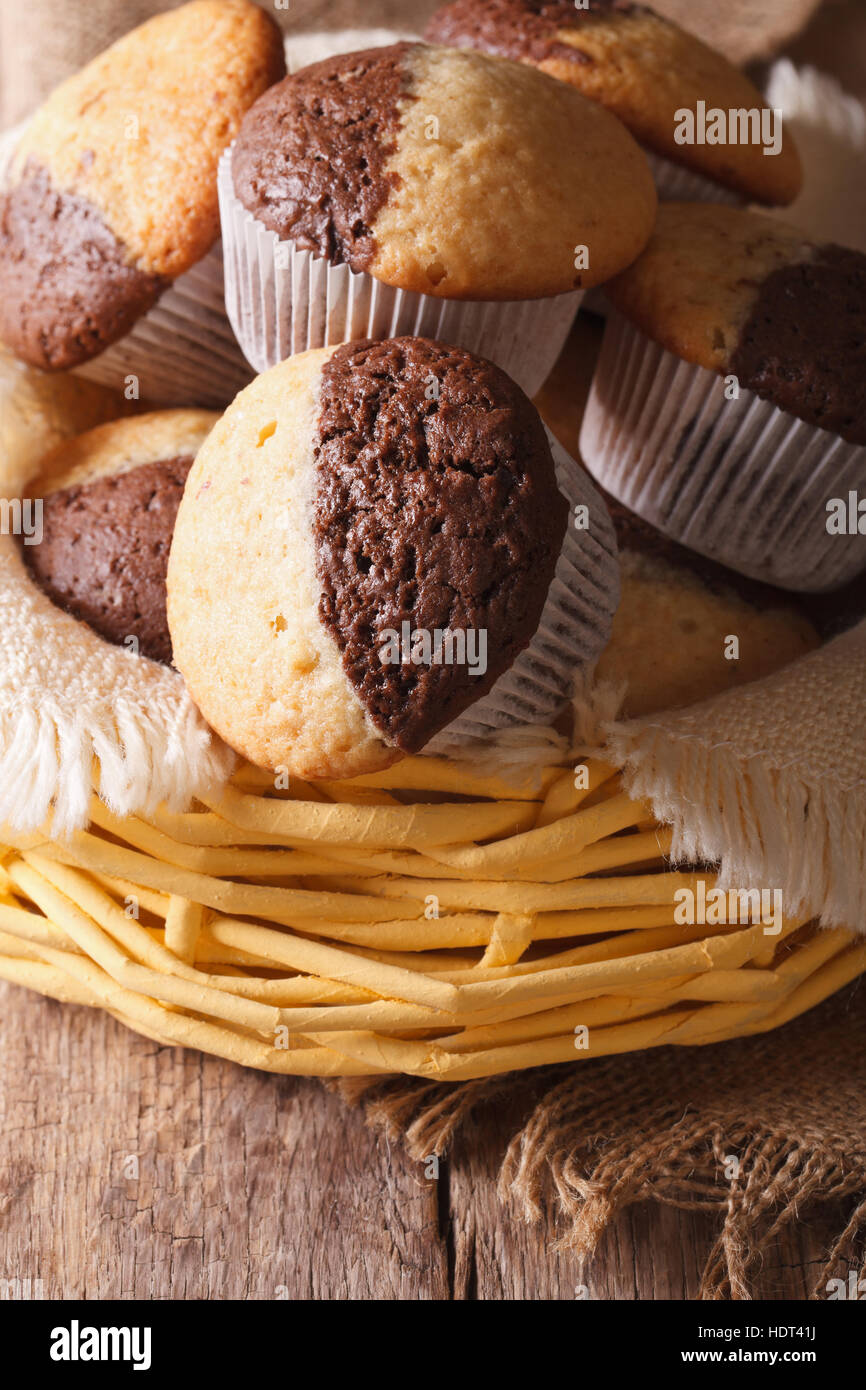 Delicious chocolate orange muffins in a basket close-up, vertical - Stock Image