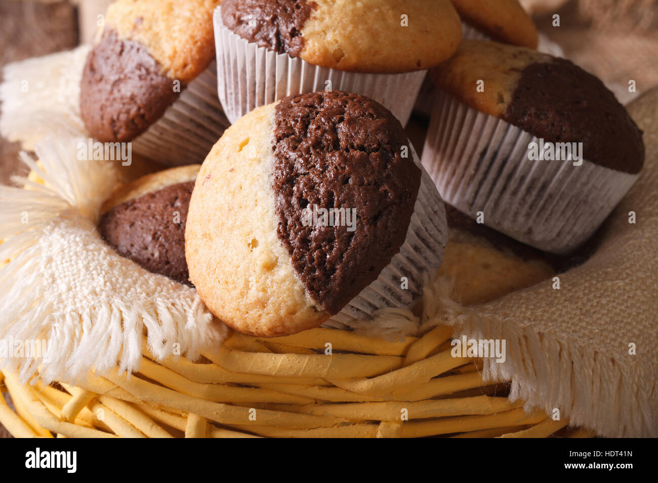 Delicious chocolate orange muffins in a basket close-up, horizontal - Stock Image