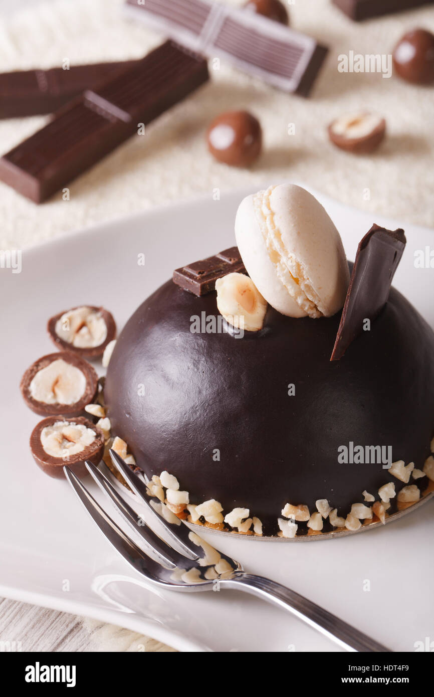 Beautiful Chocolate Cake With Nuts Topped With Macaroon On A Plate