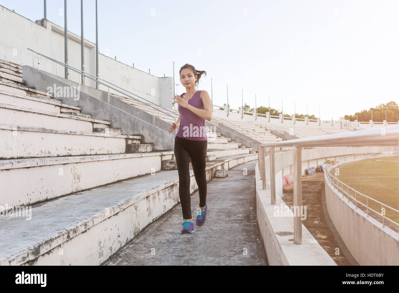 Women runners sprinting outdoors. Sportive people training in a urban area healthy lifestyle and sport concepts. - Stock Image
