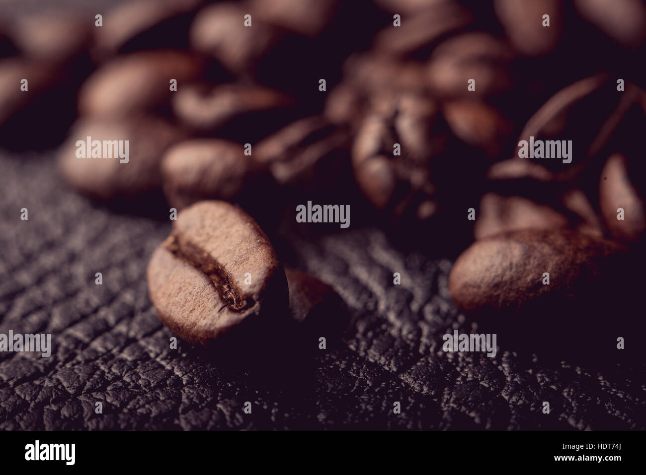 Coffee beans on the leather surface, makro pgotography, cafe concept - Stock Image