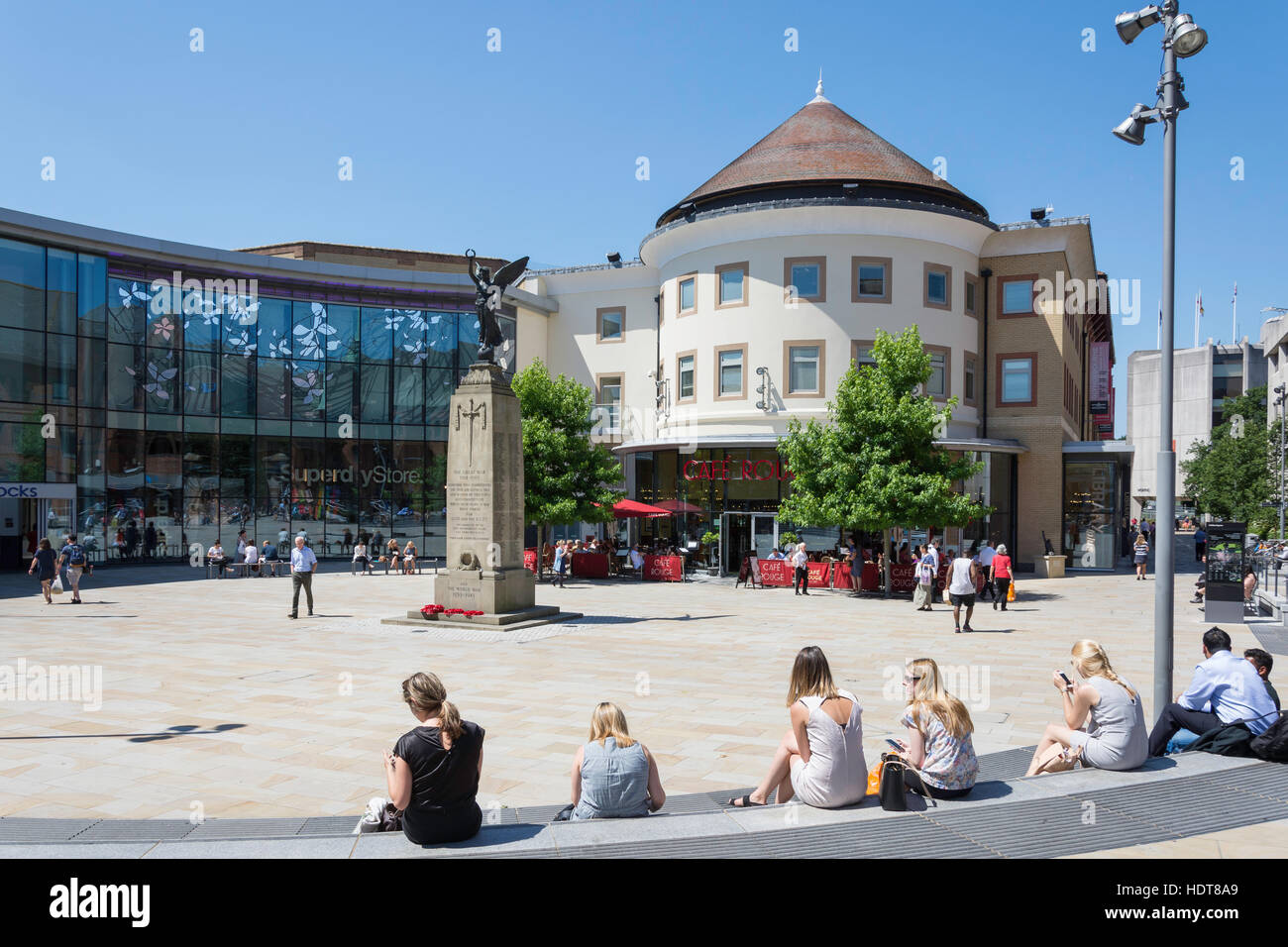 Woking Town Square showing War Memorial and The Peacocks Centre, Woking, Surrey, England, United Kingdom - Stock Image