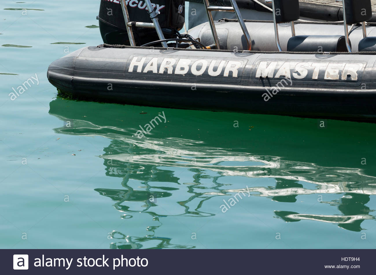 Harbour Master written on a semi-dirigible boat in Poole, Dorset, England - Stock Image