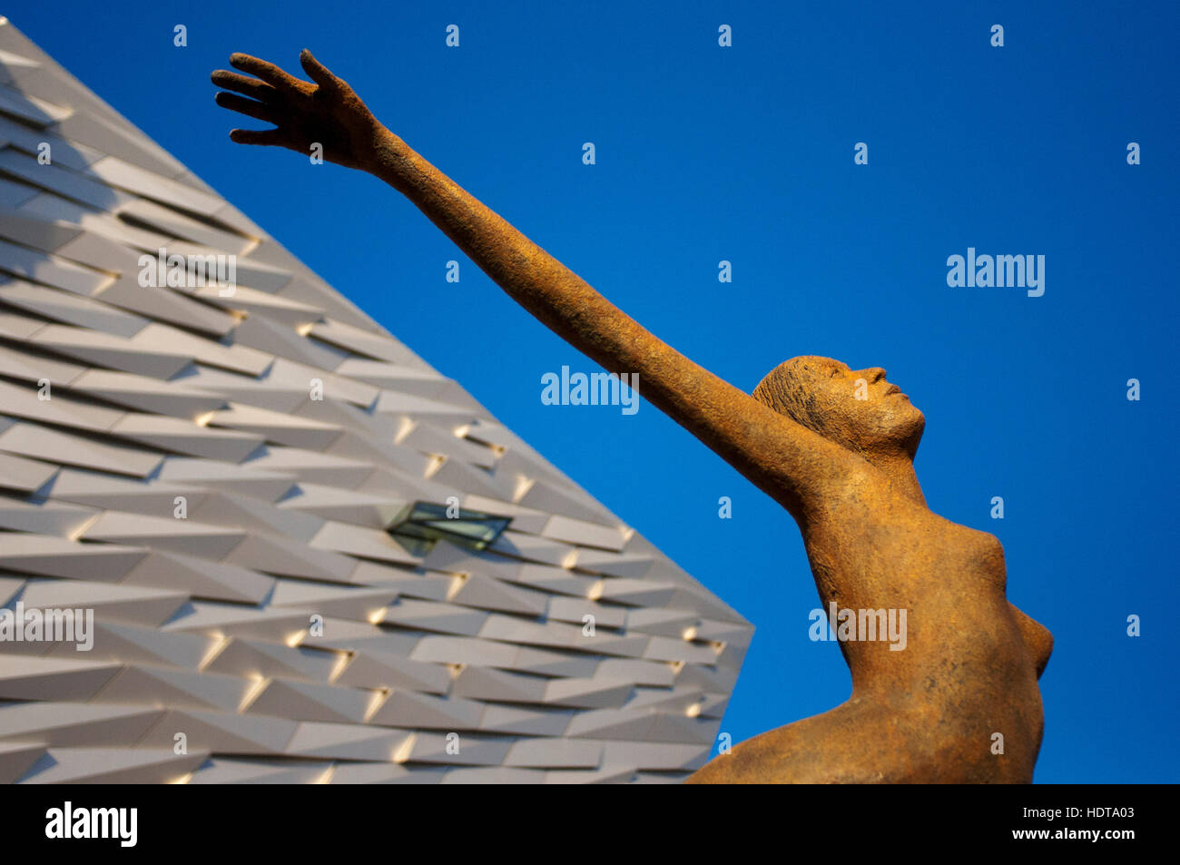 Rowan Gillespie's sculpture Titanica in front of the Titanic museum in Belfast, Northern Ireland United Kingdom - Stock Image
