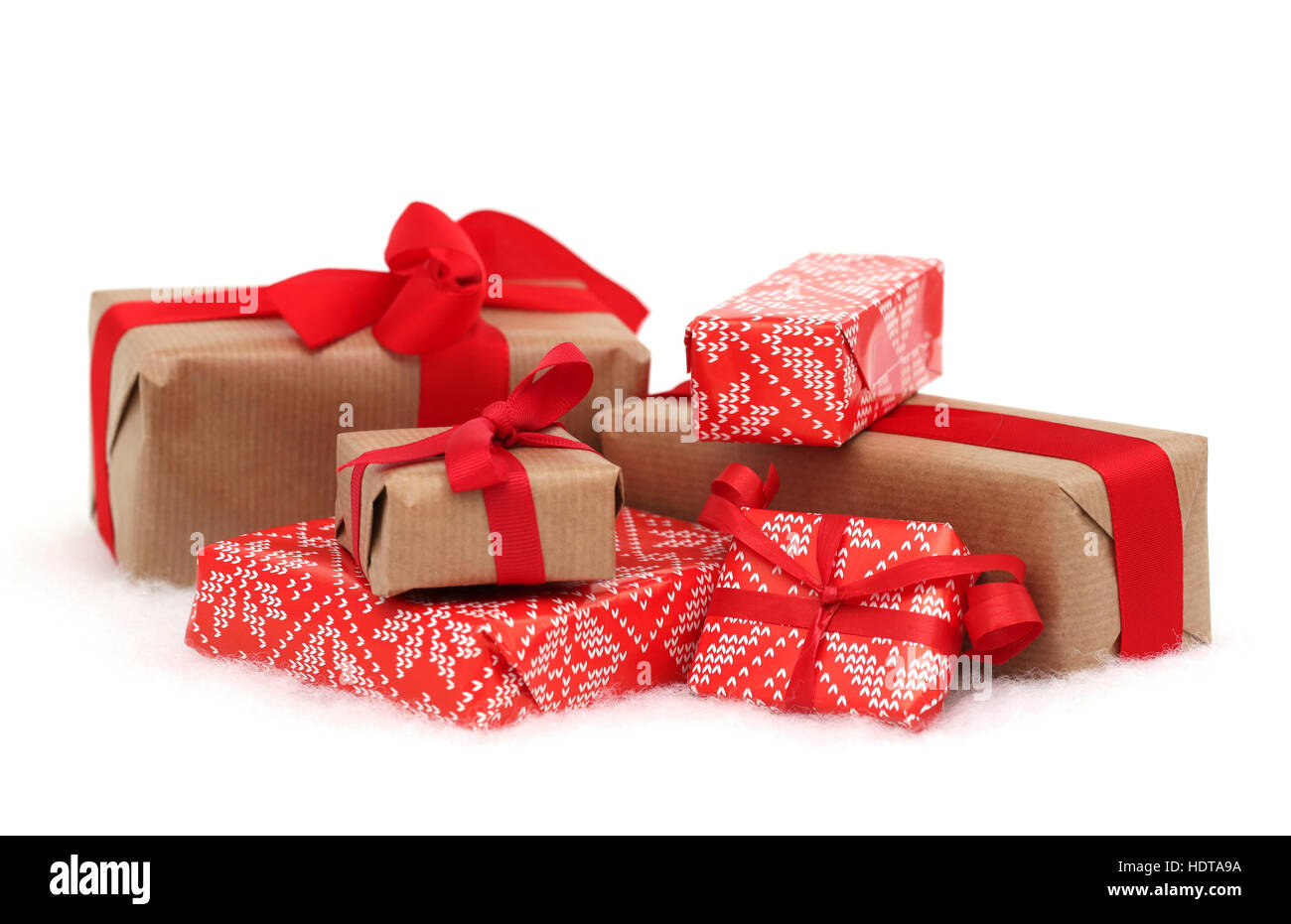 Christmas presents with red bows and ribbons against a white background - Stock Image