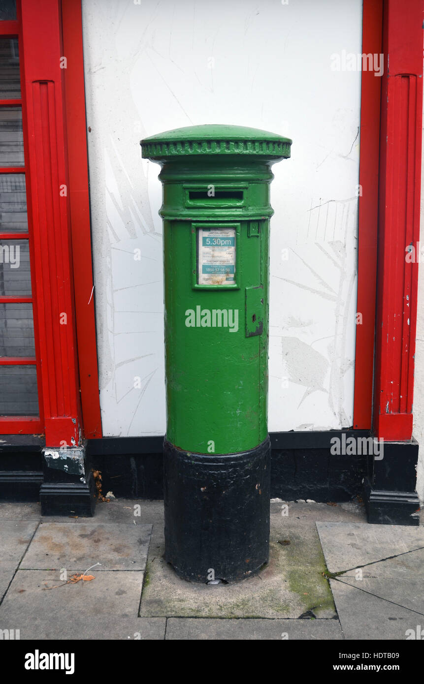 Green post box Dublin Ireland - Stock Image