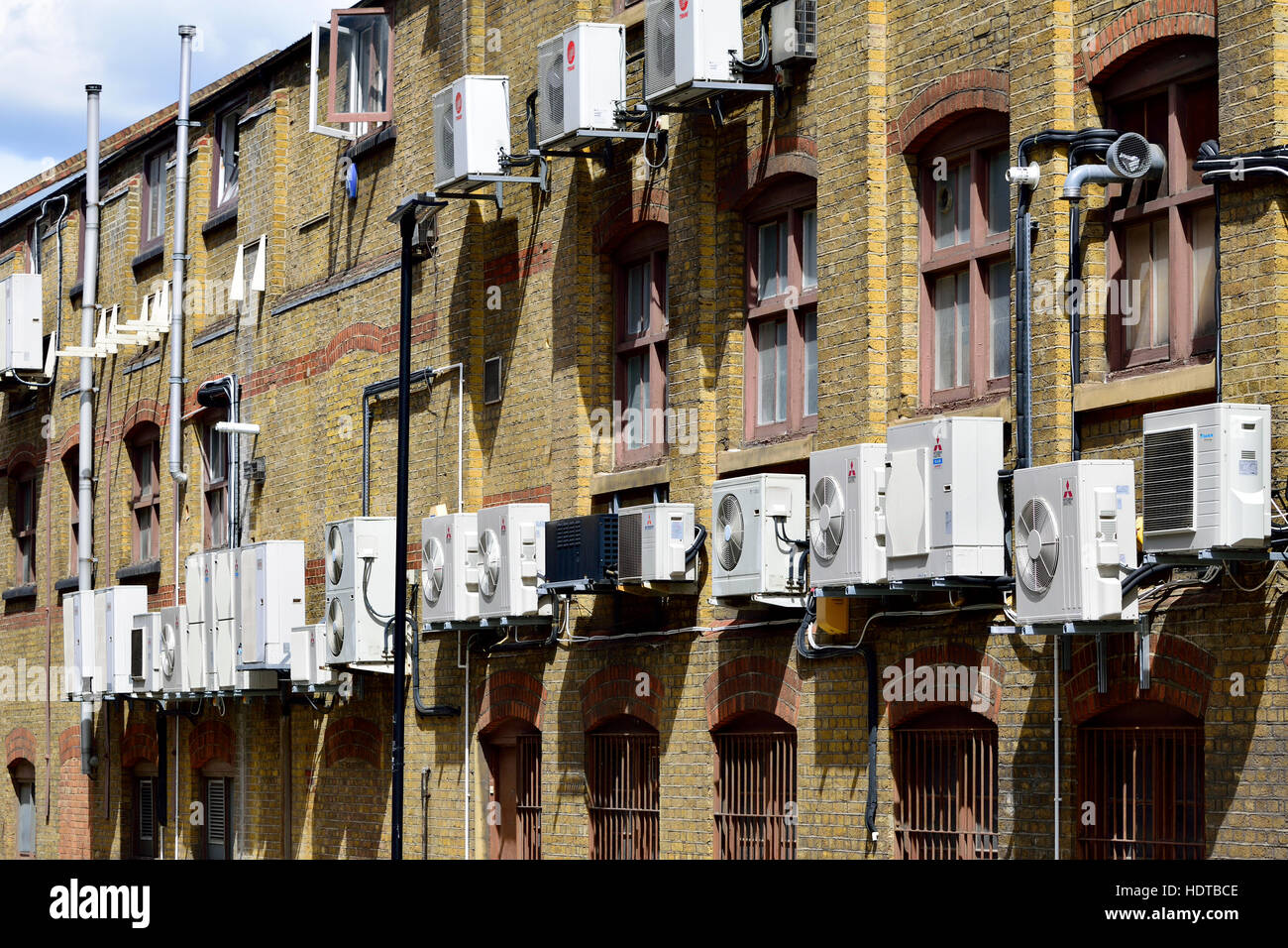 London England, UK. Air-conditioning units behind buildings - Stock Image