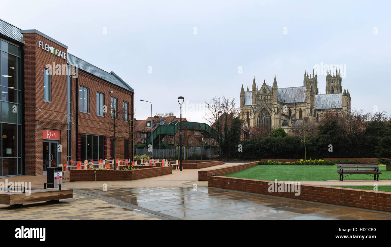 The ancient minster (church) flanked by the new shops, offices, and public spaces at Flemingate on an overcast autumn - Stock Image