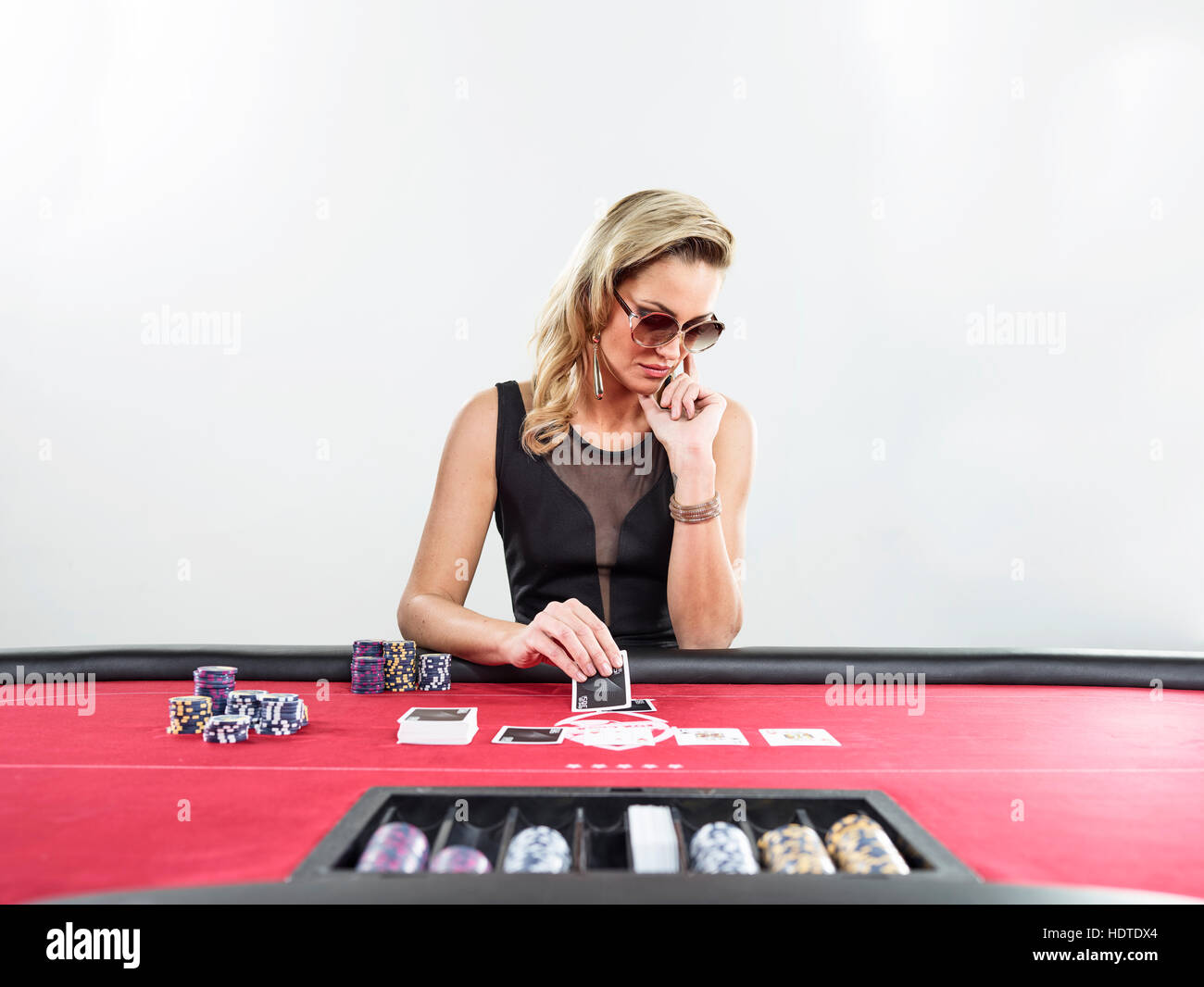 Woman playing blackjack, casino, chips - Stock Image