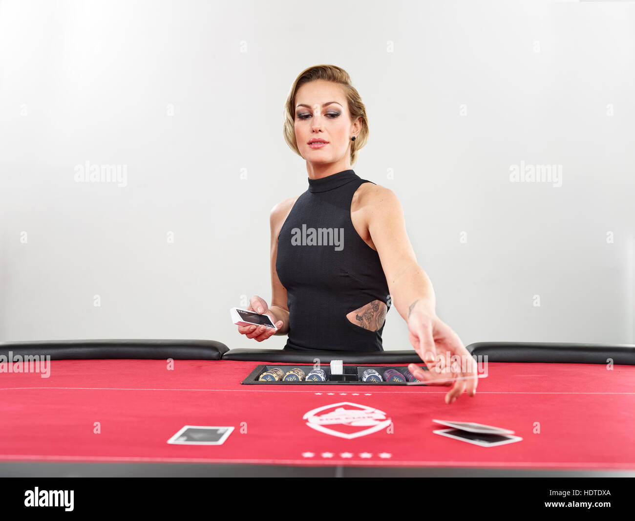 Woman playing blackjack, casino, playing cards, chips - Stock Image