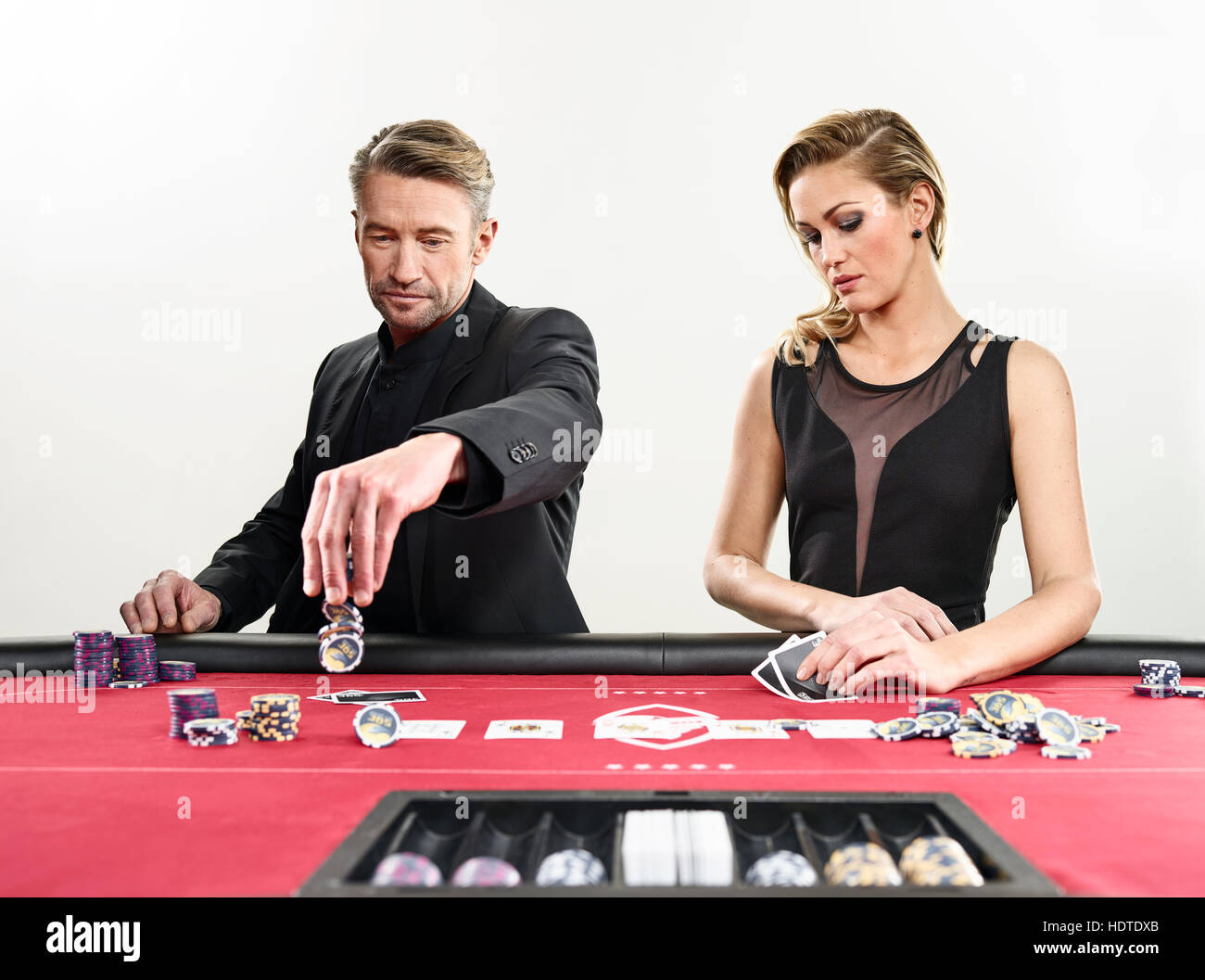 Couple playing blackjack, playing cards, chips, casino - Stock Image