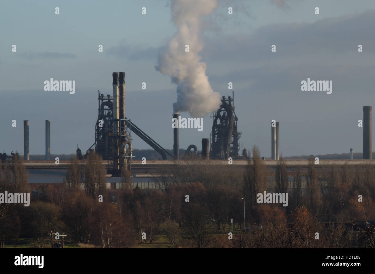 Two of Scunthorpes '4 Queens' blastfurnaces seen from the east behind various mills and workshops in December 2016 Stock Photo