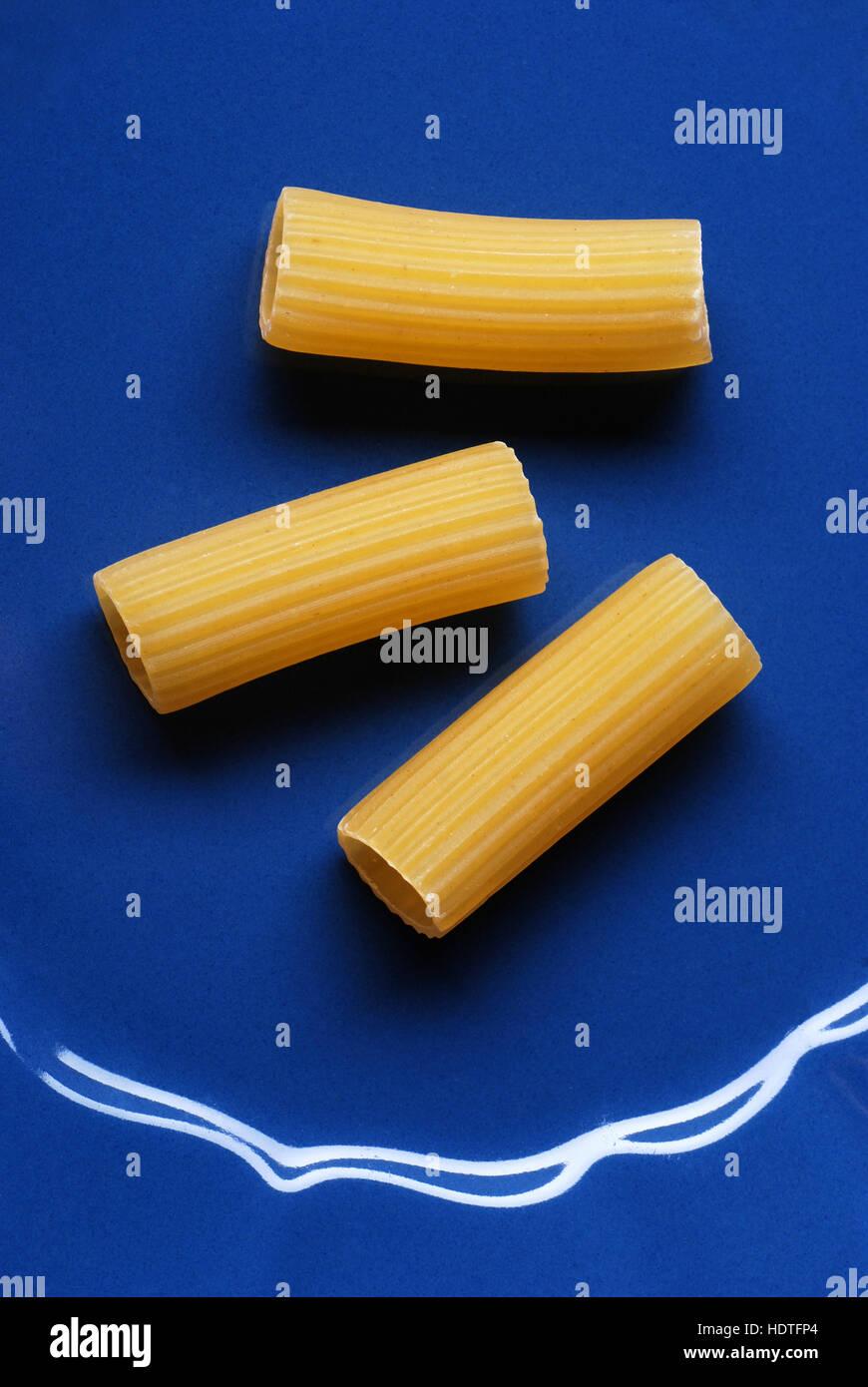 Italian raw pasta on blue dish Stock Photo
