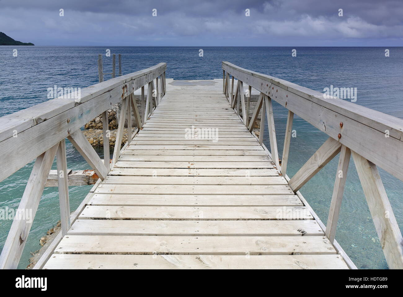 Jetty named the Queen Elizabeth II Landing in honour of a 1974 visit by the queen-used by visitors from cruising - Stock Image