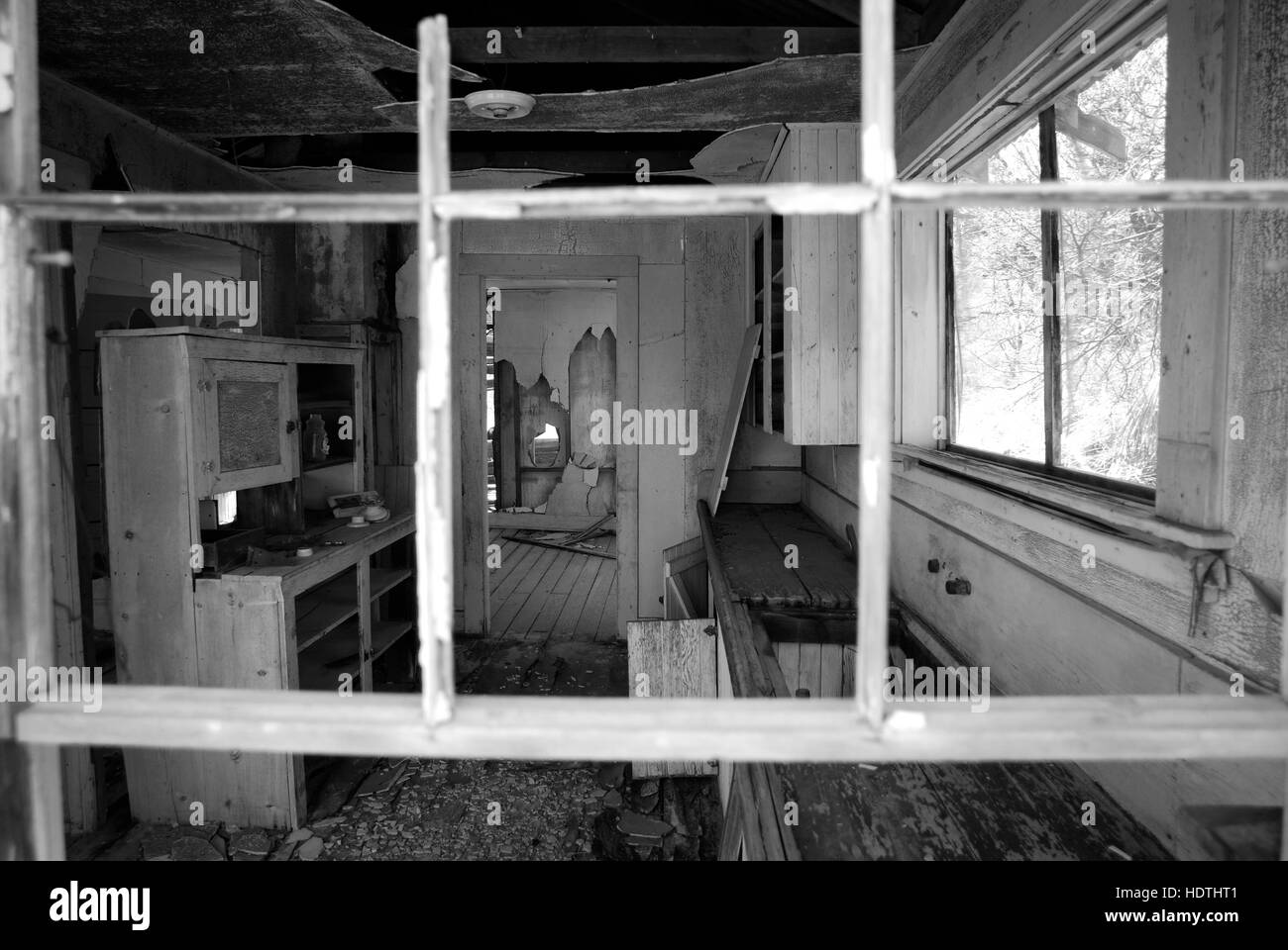 Looking inside an abandoned house in a deserted mining town in Arizona. - Stock Image