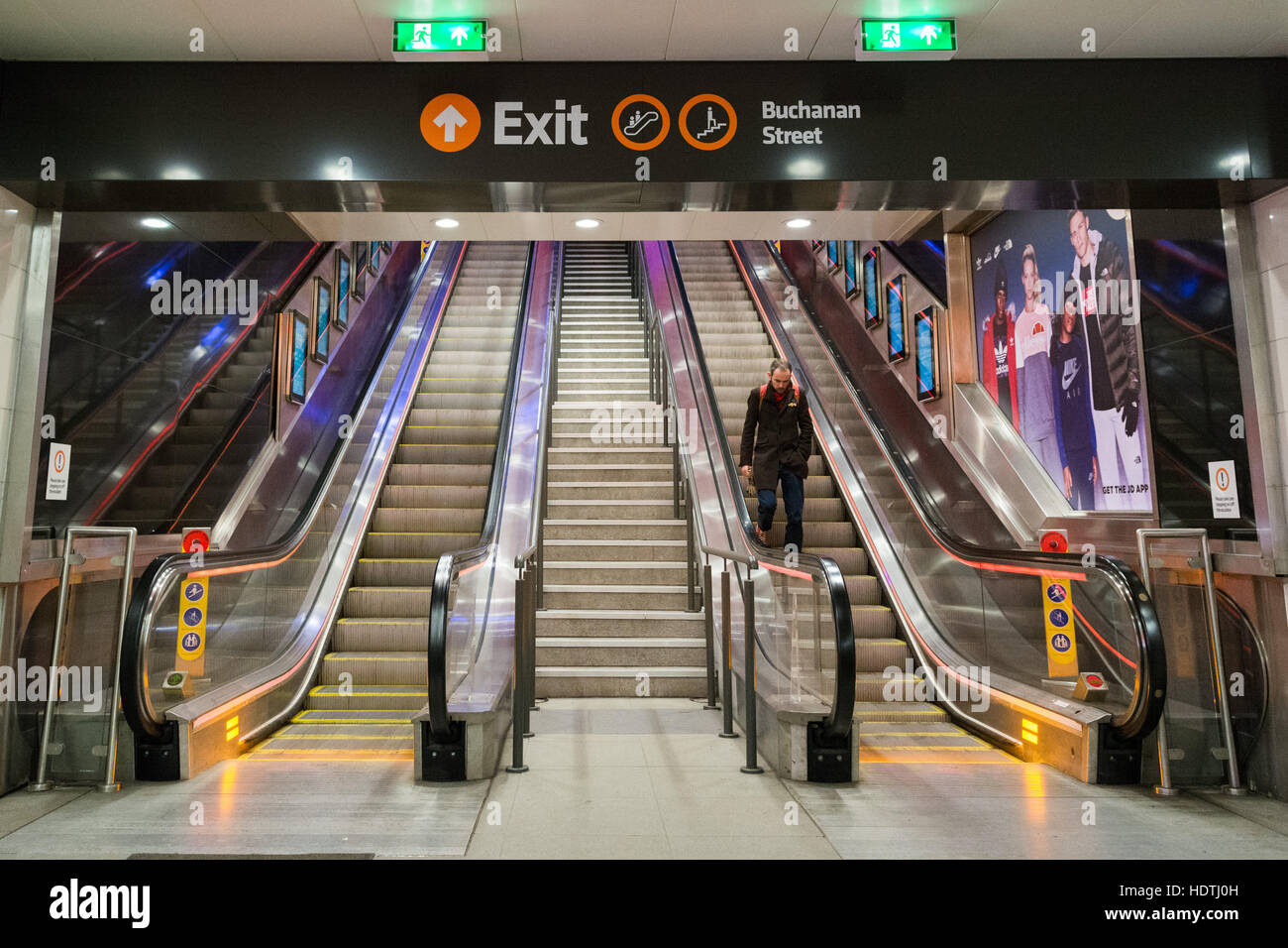 Glasgow subway - escalator to Buchanan Street exit at night - Stock Image