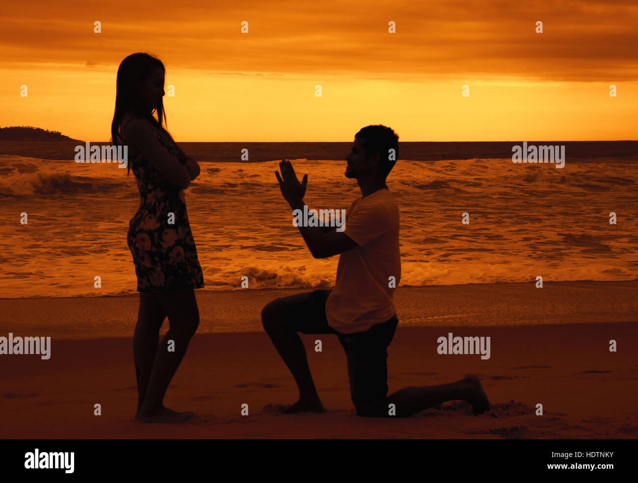 Apology of a young man outdoor at sunset - Stock Image