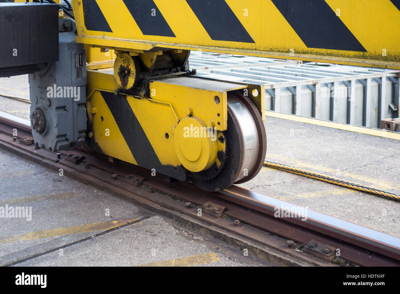Close up of track and wheels on a large lifting crane at Walbrook Wharf  London - Stock Image