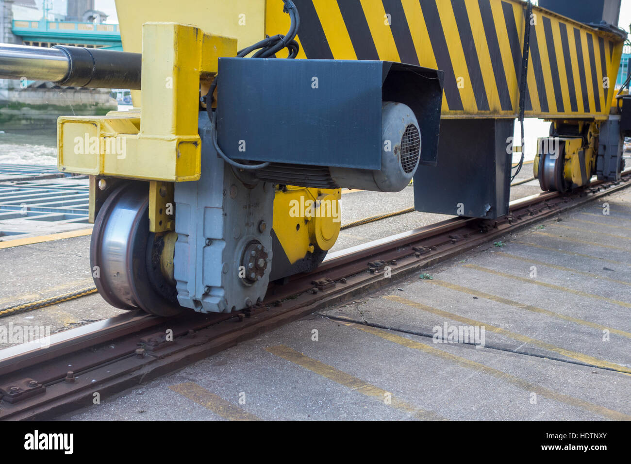 Close up of track and wheels on a large lifting crane at Walbrook Wharf. London, UK - Stock Image