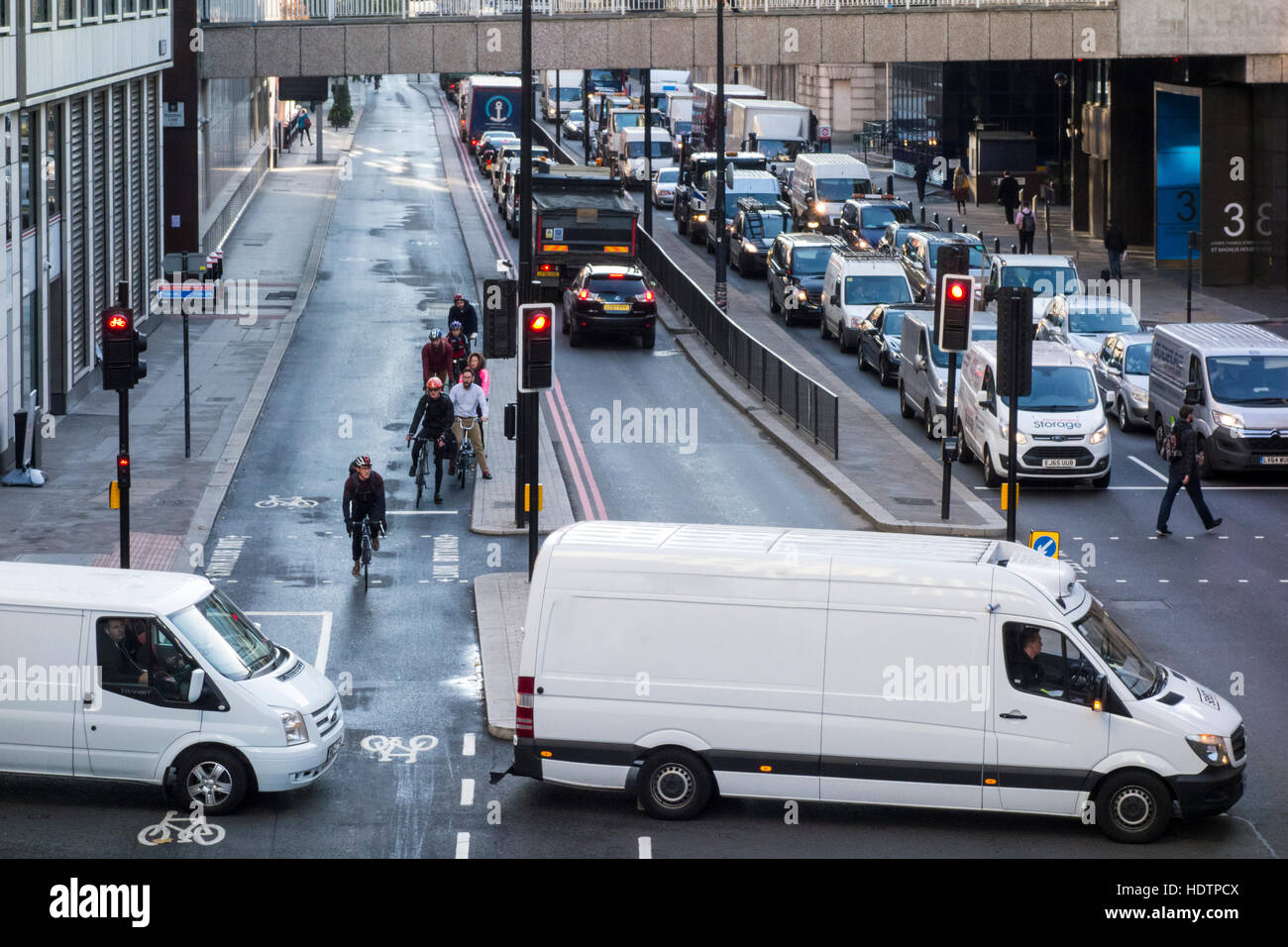 Two white vans at the junction of Lower Thames Street and Fish Street Hill, London, UK - Stock Image
