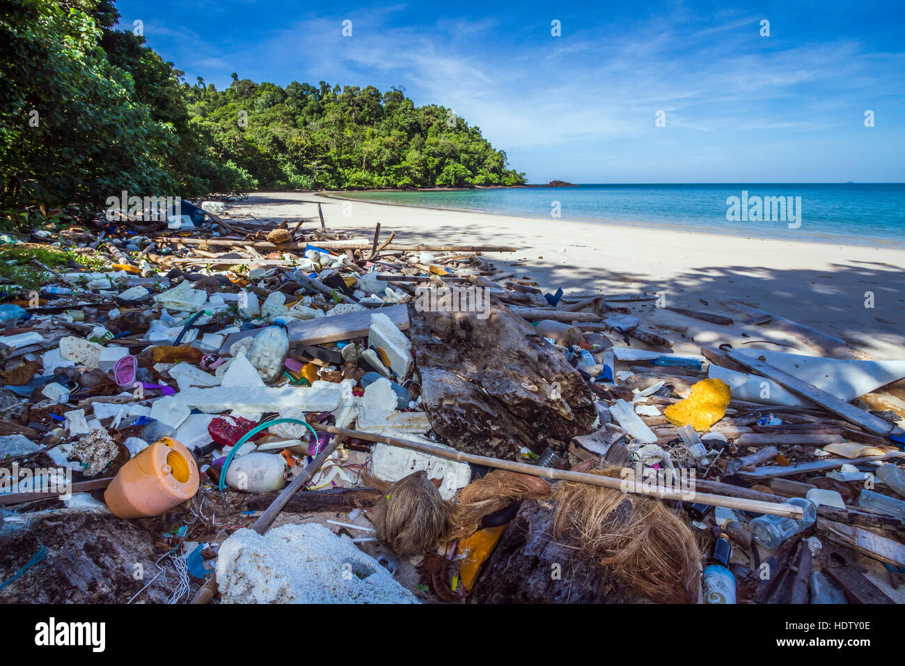 Polluted beach with rubbish in national park of Thailand - Stock Image