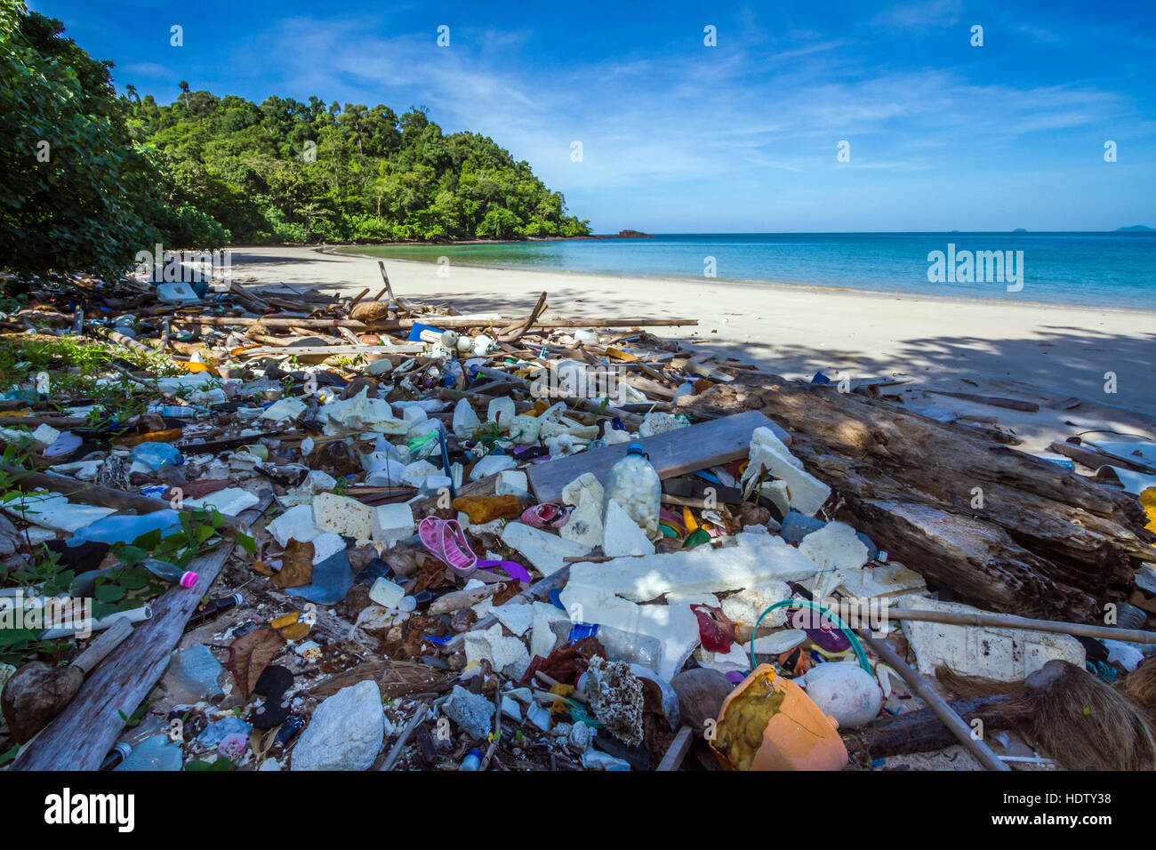 Polluted beach with rubbish in national park of Thailand Stock Photo