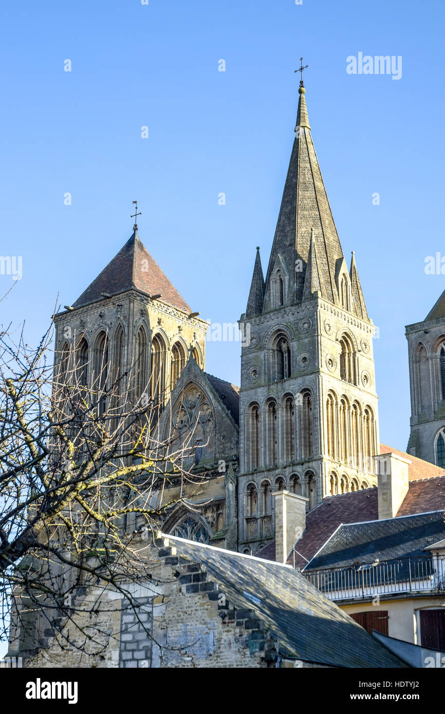 Medieval abbey towers of Saint-Pierre-sur-Dives are seen throughout the town and from several miles/kilometres away - Stock Image