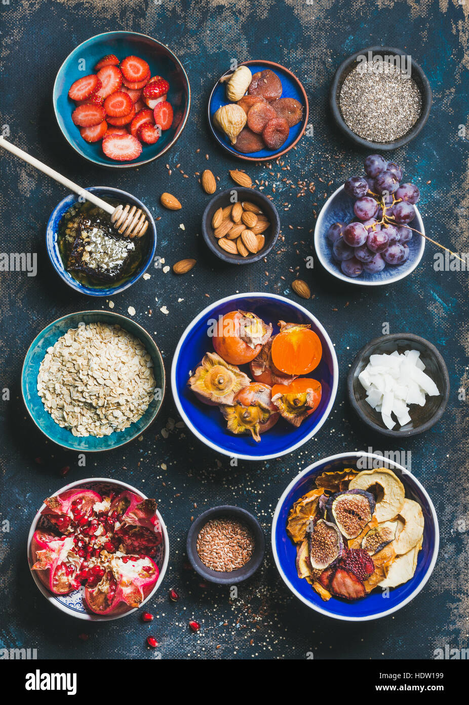 Fresh and dried fruit, chia seeds, oatmeal, nuts, honey - Stock Image