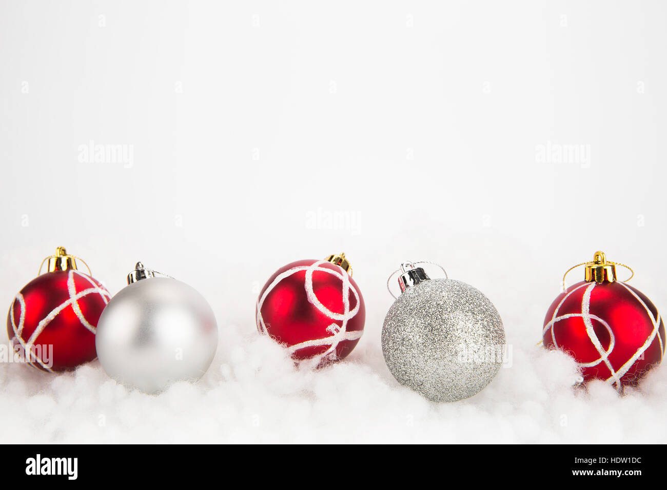 Red And Silver Christmas Balls On Abstract White Background